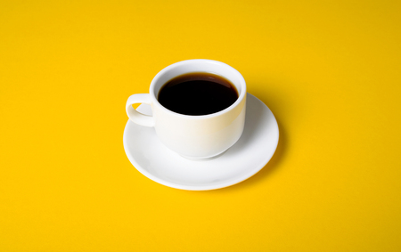 Cup of coffee drink on yellow background Stock Photo - 117888614