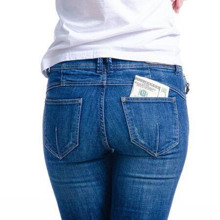 Woman puts money dollars in jeans pocket Banco de Imagens