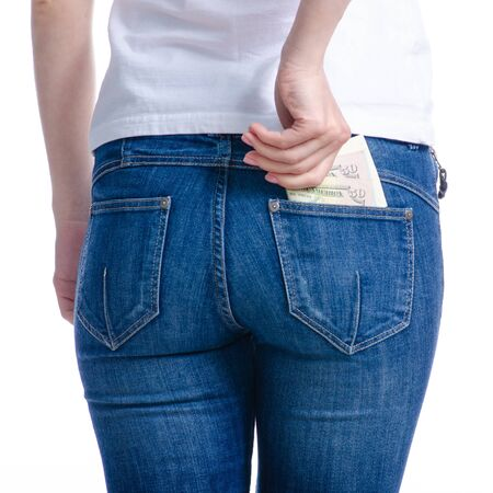 Woman puts money dollars in jeans pocket