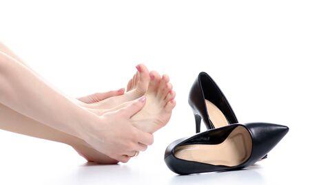 Female legs black high heels pain