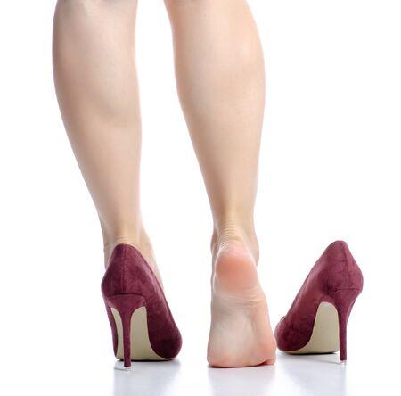Female legs red high heels pain beauty Foto de archivo