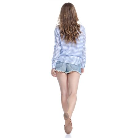 Woman in denim shorts goes walking