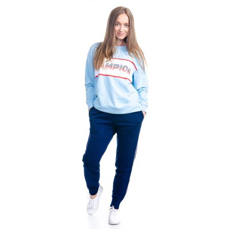 Woman in blue sweatpants sport style casual goes walking smiling