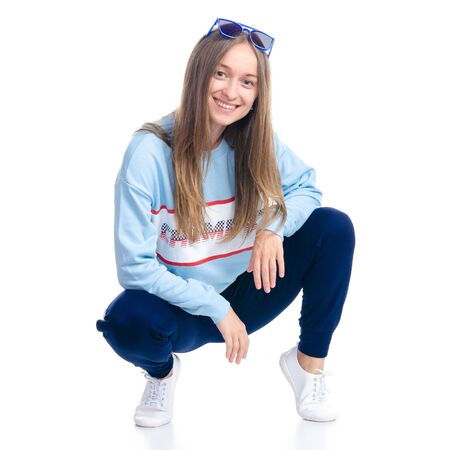 Woman in blue sweatpants with sunglasses sport style casual sat down smiling happiness Imagens