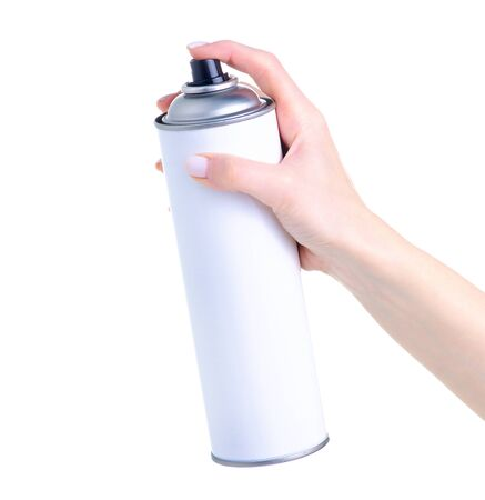 Black paint bottle in hand on white background isolation