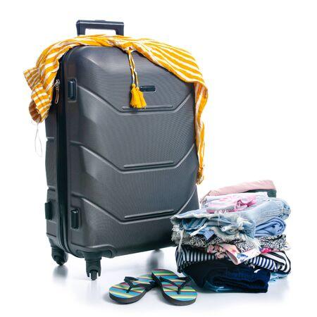 Black travel suitcase and clothing luggage summer Archivio Fotografico