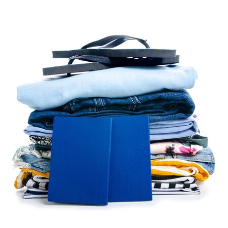 Pile stack summer clothes on white background isolation, trip concept