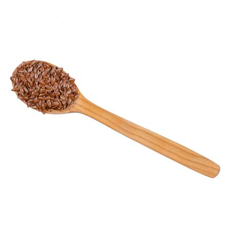 flax seeds in wooden spoon on white background isolation, top view