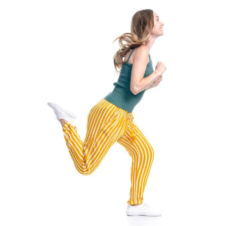 Woman in yellow pants smiling happiness goes walking running
