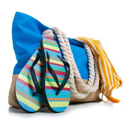 Summer holidays, vacation and travel concept. Beach handbag travel, flip flops