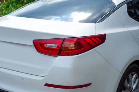Vehicle tail lights white in the street