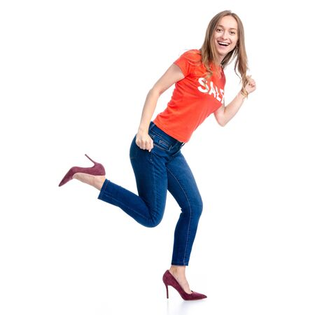 Woman in shirt and high heels shoes sale shopping fashion goes running smiling happiness Archivio Fotografico