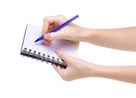 Notepad diary and pen in hand