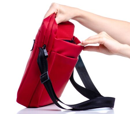 Red messenger bag in hand