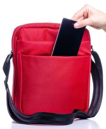 Smartphone put into red messenger bag