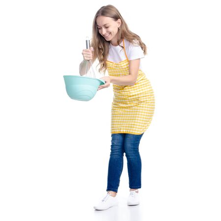 Woman in blue apron with kitchen bowl whisk corolla in hand