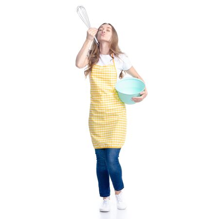 Woman in blue apron with kitchen bowl whisk corolla in hand Reklamní fotografie - 145593165