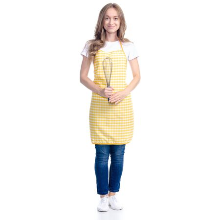 Woman in yellow apron with kitchen whisk corolla in hand