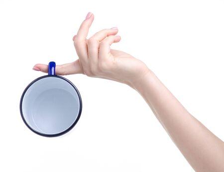 Blue enamel cup in hand