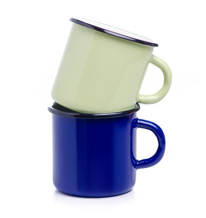 Green and blue enamel cup on white background isolation