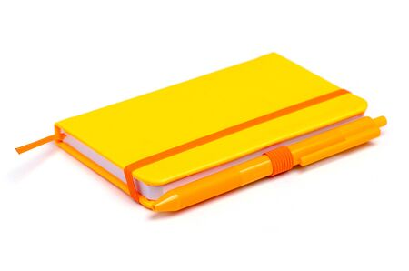 Orange notebook diary with pen