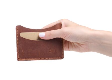 bank card in leather card holder in hand