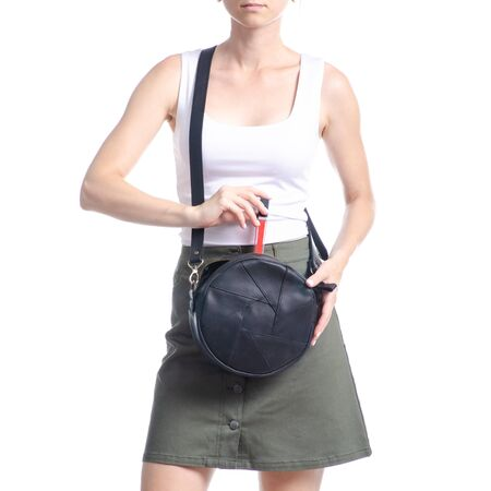 Woman with black round bag fashion, put lipstick on white background isolation Banque d'images