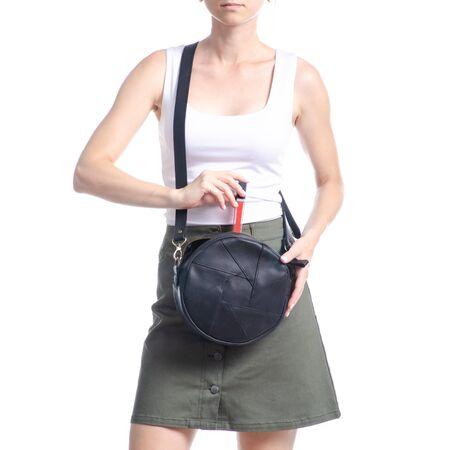 Woman with black round bag fashion, put lipstick on white background isolation Reklamní fotografie