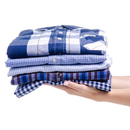Stack folded casual blue shirt holding hand