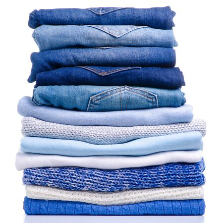 Stack folded blue shirt clothing and jeans