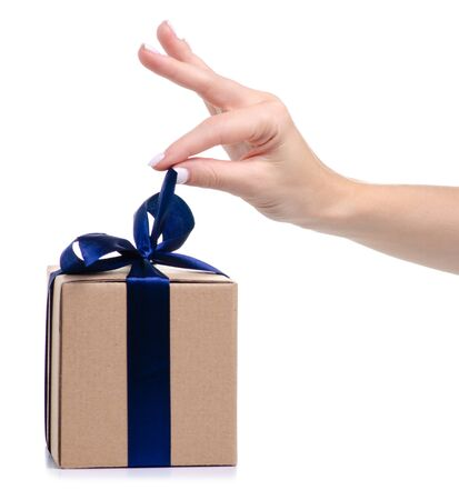 Brown box with blue ribbon bow gift in hand