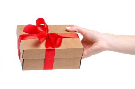 Box with red ribbon bow gift in hand Reklamní fotografie - 145817401