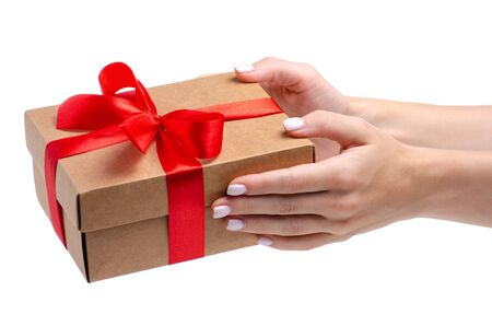 Box with red ribbon bow gift in hand