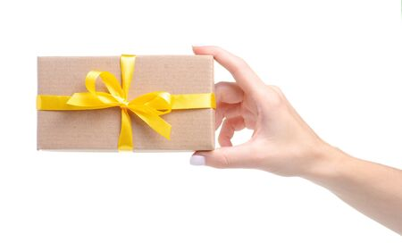 Box with yellow ribbon bow gift in hand