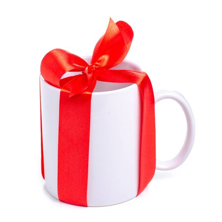 White cup mug with red ribbon bow gift Reklamní fotografie - 145817413