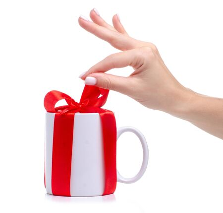 White cup mug with red ribbon bow gift in hand