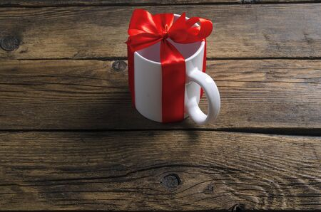 White cup mug with red ribbon bow gift