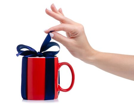 Red cup mug with blue ribbon bow gift in hand 版權商用圖片