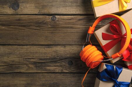 Orange headphones music audio, box with ribbon bow gift