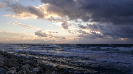 Beauty sunset, nobody coastline of Mediterranean Sea, cold winter, Haifa, Israel