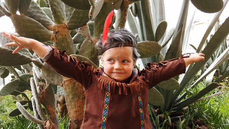 Cute little boy act the ape, dressed in native american indian costume. Ready for Purim party, Israel culture holiday