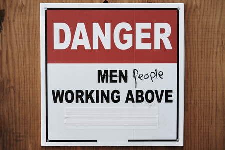 Obsolete sign on the construction site. Womens Movement for Equality. Concept feminism