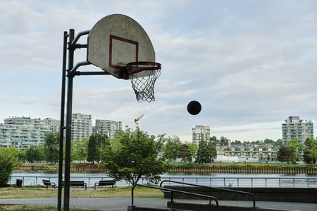 Basketball court in urban area. Dusk, dramatic view. Vancouver BC, Canada