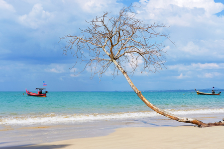 Amazing landscape of Andaman Sea, Thailand. Blue sky, azure water and fishing boat. Concept: travel destination, exotic place Stock Photo
