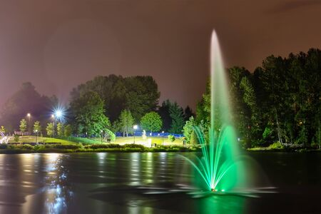 Lafarge lake public park fountain in Coquitlam city, Great Vancouver, BC, Canada