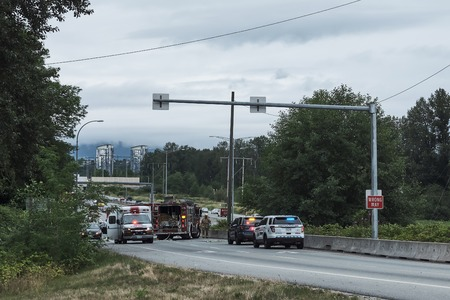Burnaby, Canada - July 18, 2018: Road accident. Fire truck police and ambulance on highway
