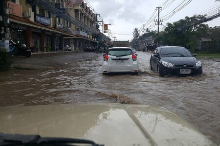 Koh Samui, Thailand - October 11, 2017: Traffic on flooded road