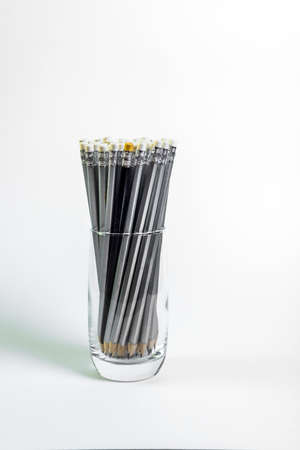 Simple pencils for office workers. Pencils for drawing. The pencils are in the glass. Simple pencils for school children and students. For business.