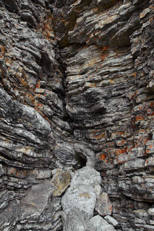 compacted: compacted rock formation close up Stock Photo