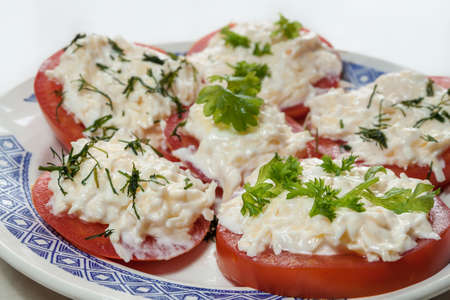 entrees: appetizer of tomatoes with cheese and herbs